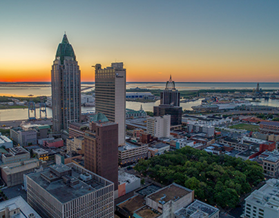 Downtown Mobile during two separate sunrises