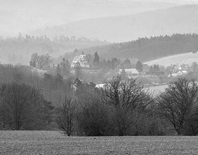 Foggy countryside landscape in B&W