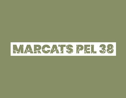 Marcats pel 38 Logo