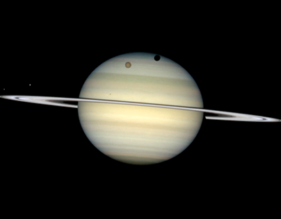 Saturn Moons and Tropical Storm