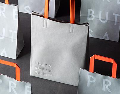 PRESS BUTTER SAND - Brand TOTE