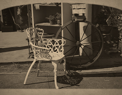 White Chair and Tractor Wheel