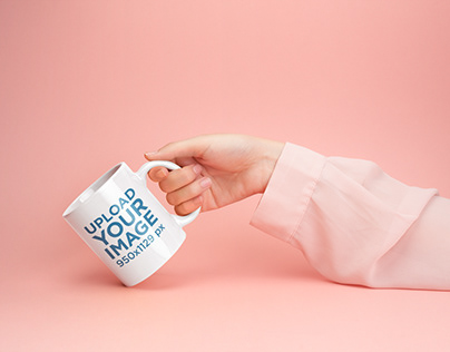 Mockup of a Woman's Hand Holding a Coffee Mug