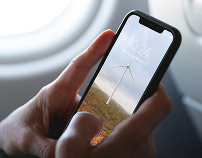 Free iPhone XS on a Plane Mockup