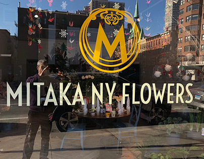 Window sign painting for NYC florist