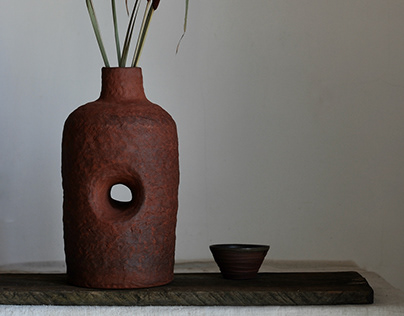 A Deep Red Hollow Wild Clay Vase