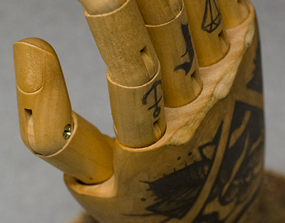 Wooden hand tattooed