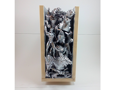 Silver toy sculpture