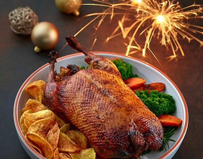 Freshly roasted duck roast with christmas lights