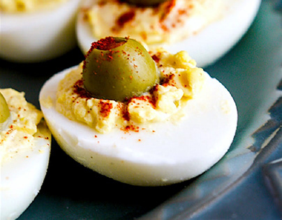 Hard-boiled eggs with olives
