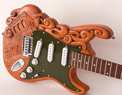 Guitarra tallada