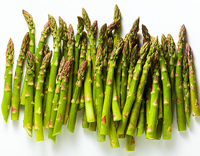 Group of ripe fresh spring asparagus isolated on white