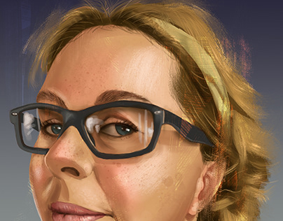 Portrait of a blonde woman with glasses