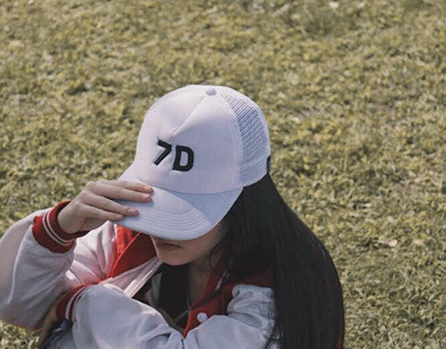 The Girl Behind The White Cap