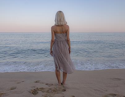 Girl in front of the ocean.