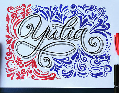 Lettering in calligraphic style with colorful decor