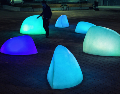 'MARBLES' Interactive glowing forms playing with people