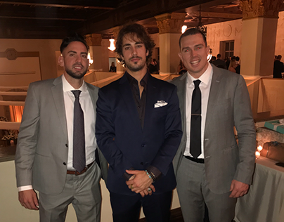 Brock Rasmussen and friends celebrate at a wedding
