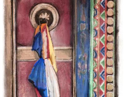 Tibetan prayer flags adorn a monastery door in Ladakh