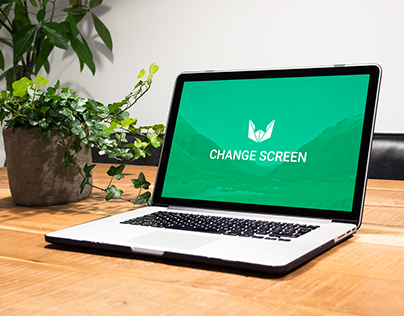 Free macbook mockup on wooden table with plants