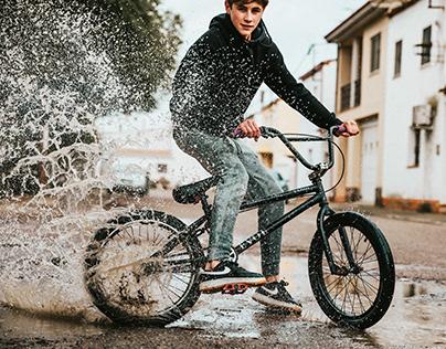 Riding a bike on a rainy day