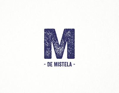 M de Mistela | Identity