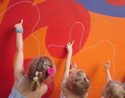 Volunteer kindergarten painting