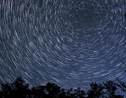 Shooting night sky with stars