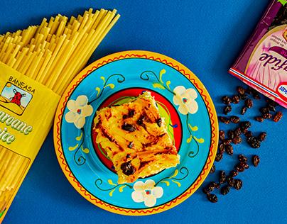 Macaroni with cheese and golden raisin dish