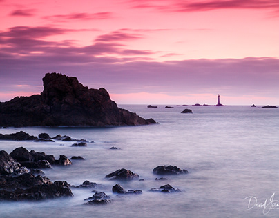 Sunset over Les Hanois Lighthouse in Guernsey