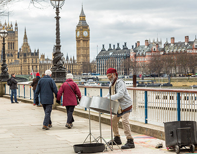 A steel-drum busker, marching soldiers and a vagrant