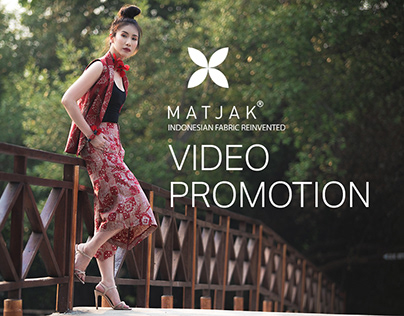 Matjak's video promotion that shows a woman leaning on a fence wearing a matjak's batik product
