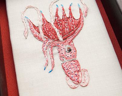 Embroidered sketch of umbrella squid