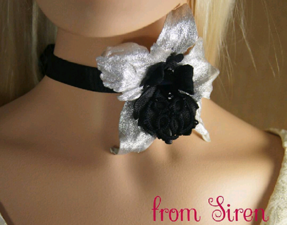 The choker with flowers.