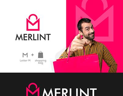 M + shopping bag logo design