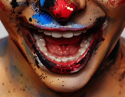 Beauty female Model with Clown Faceart. Creative Makeup