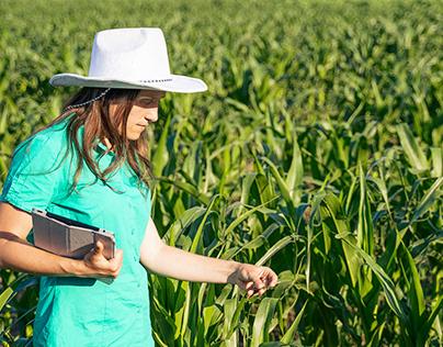 Young Cheerful Entrepreneur in an Organic Farm