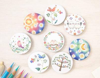 """Flowers, Birds, Moon, and Sun Button Badges"""
