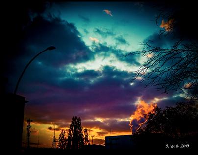Evening sky with smoking chimney in Berlin