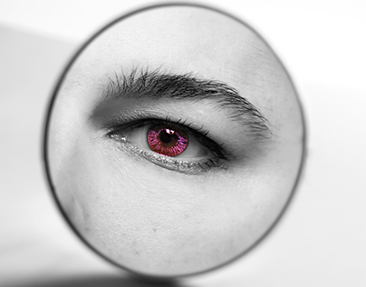Purple eye in the mirror
