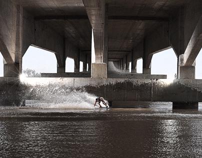 Wakeskating under the bridge