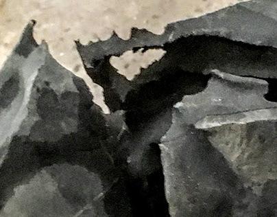 Acid eroding stone.