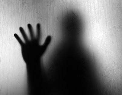 4K Dark Shadow of a Hand Touching Blurry Opaque Glass