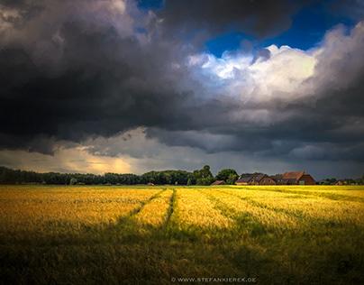 Farm under clouds