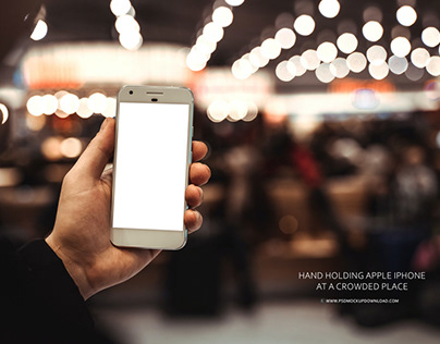 Hand holding apple iphone at a crowded place Mockup