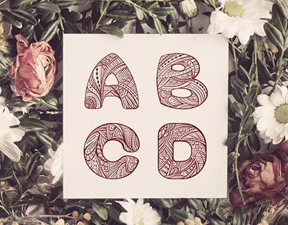 Capital letters A, B, C, D in zendoodle style.