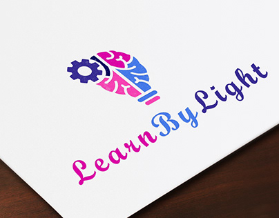 A logo for Learn By Light website