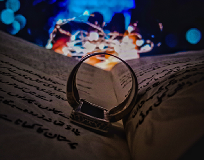 a bokeh photograph of a ring.