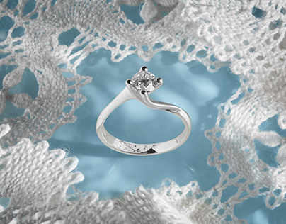Jewelry photography of diamond ring on handmade lace
