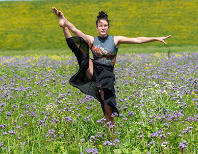 Dancing in a field of flowers.
